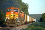 BNSF 4965, strong sun greets the westbound empty hopper train